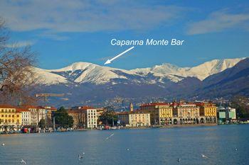 01 von links Caval Drossa(1632m), M.Bar(1816m), Camoghe(2228m),Gazzirola(2118m) als Hintergrund für Lugano, Februar 2009
